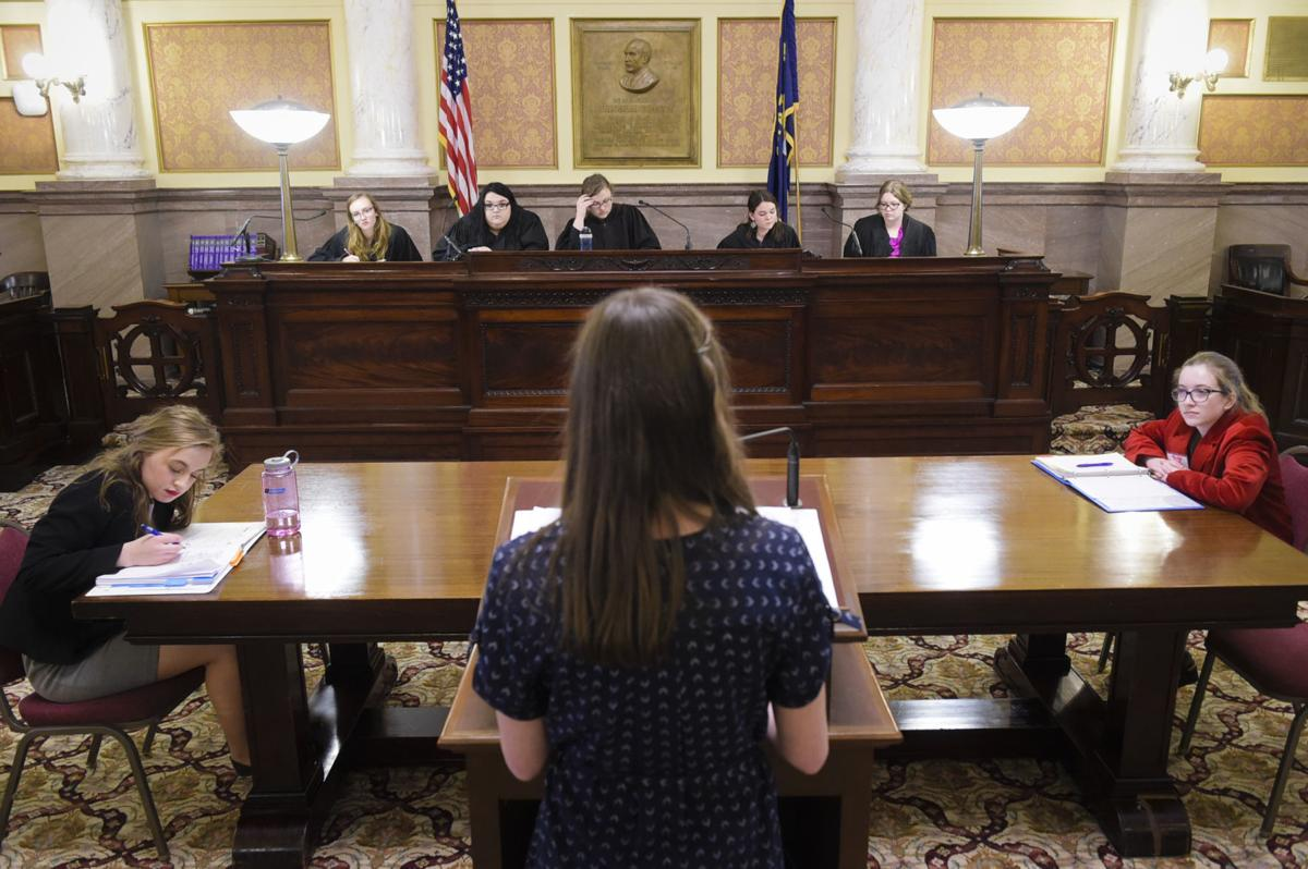 Hallie Burnett, center, argues a case in front of a mock Montana Supreme Court Monday afternoon during the 47th Youth Legislative Session.