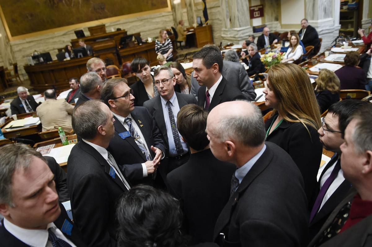 House Republicans and Democrats gather in the center aisle Friday morning.