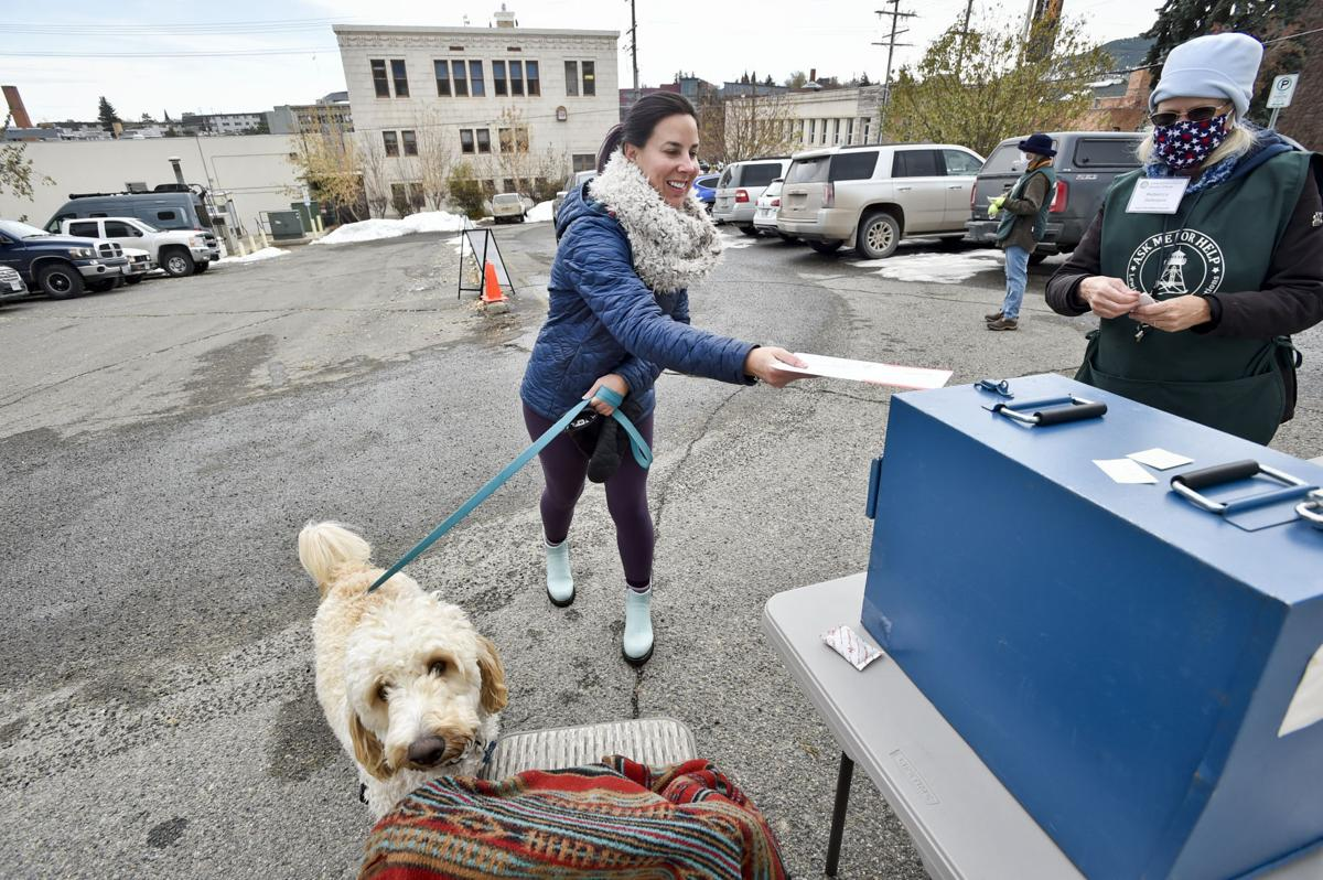 Kourtney Fisher and her dog Levi drop off a ballot
