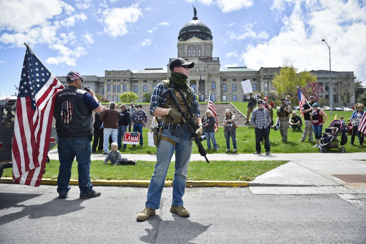 Protesters gather outside the Montana State Capitol Wednesday criticizing Gov. Steve Bullock's response to the COVID-19 pandemic.