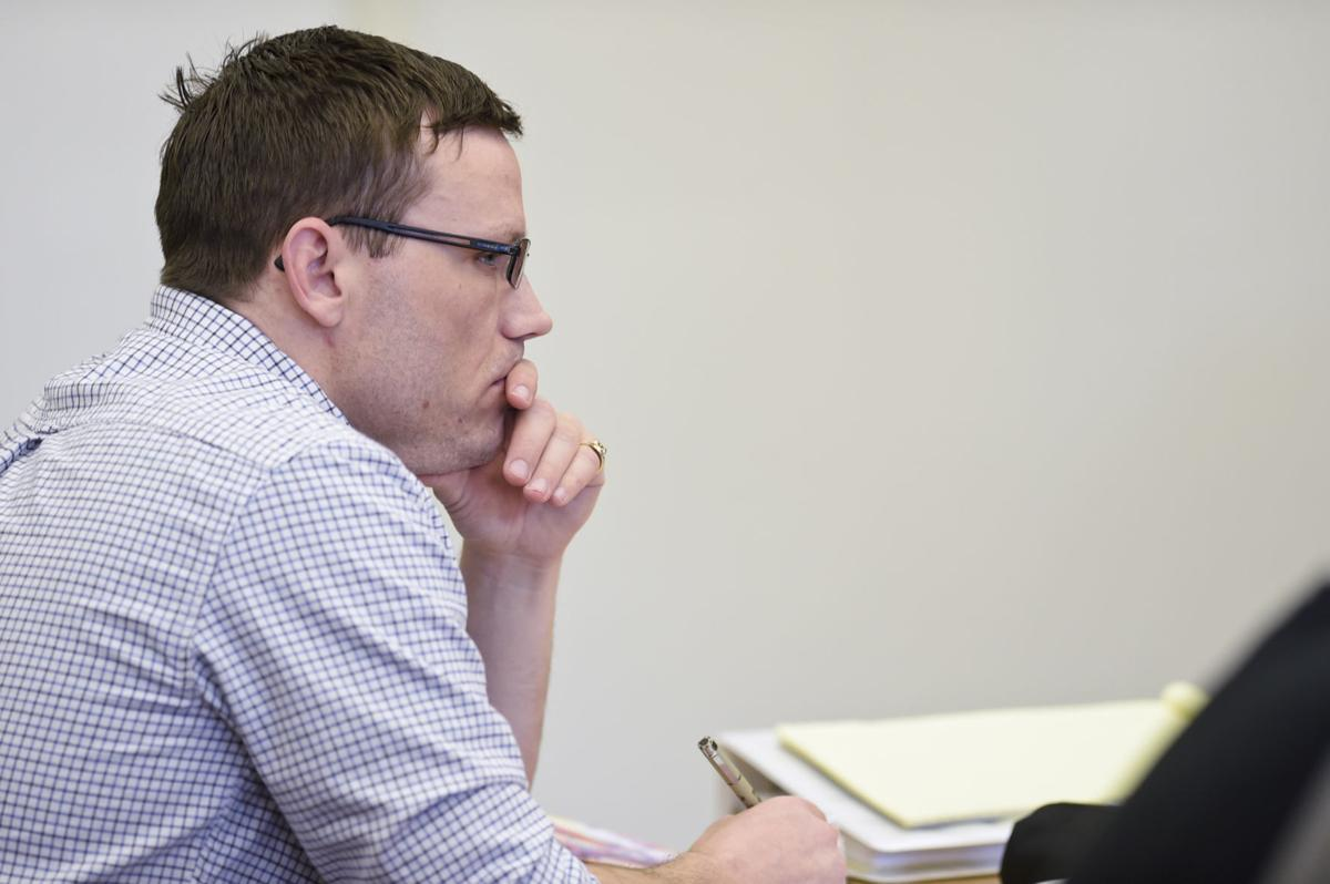 Andrew Pierce Lake listens to an opening statement during his trial Tuesday at the Lewis and Clark County Courthouse.