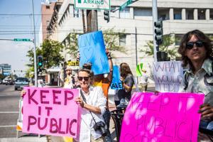 A dozen Missoulians protest Zinke, Trump
