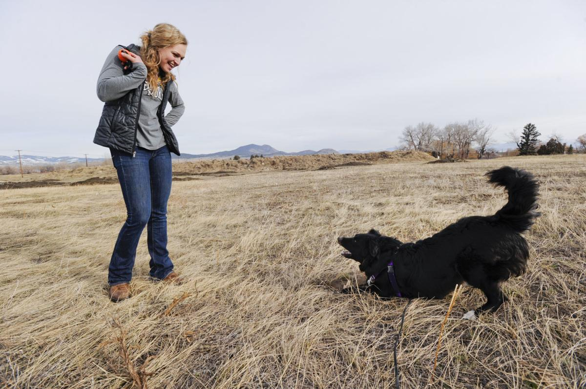 Hannah Decker, a senior anthrozoology student at Carroll College, praises Dax