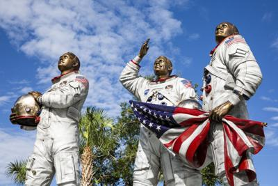 The new Moon Tree Garden features a statue of Apollo 11 astronauts Michael Collins, Neil Armstrong and Buzz Aldrin at Kennedy Space Center Visitor Complex's Apollo/Saturn V Center on Friday, July 12, 2019.
