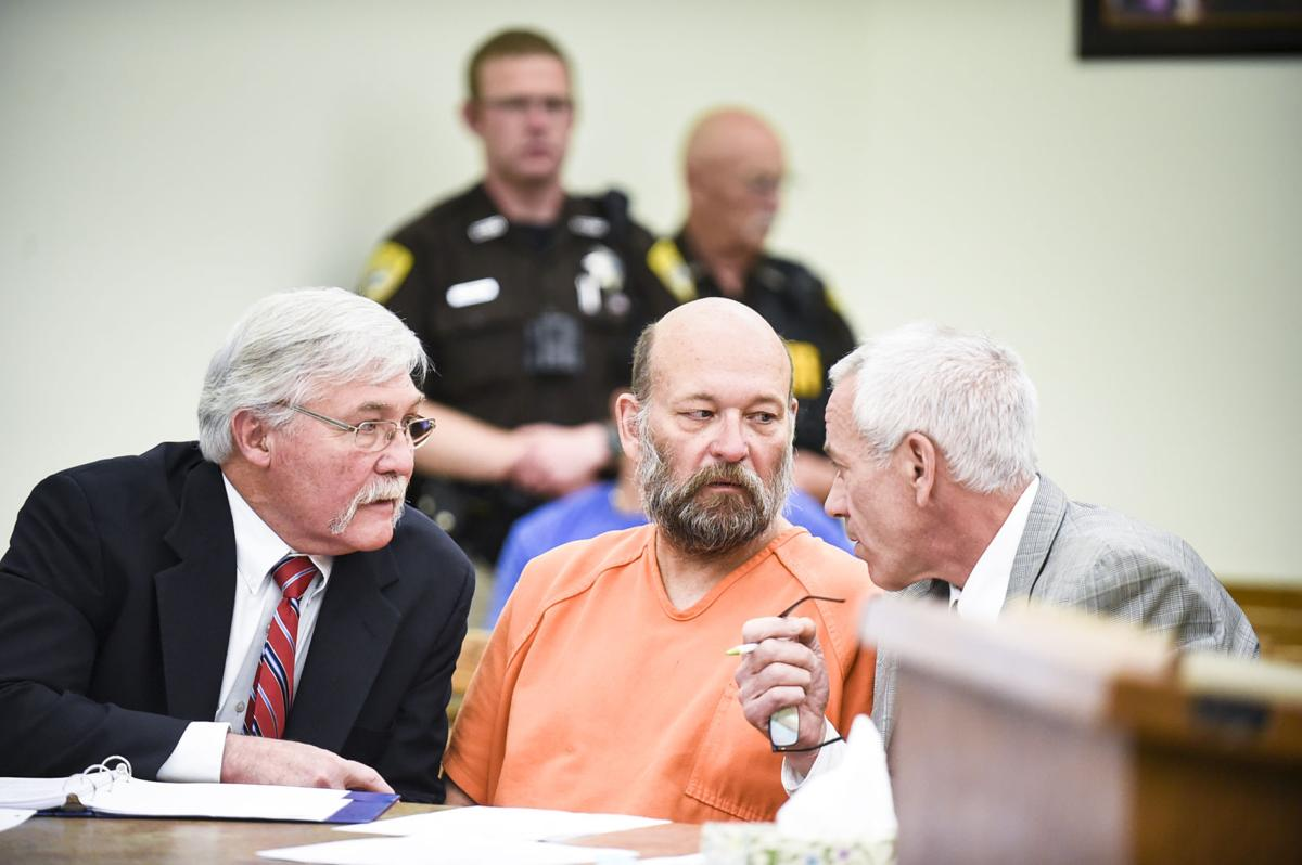 Lloyd Barrus, 61, center, speaks with his lawyers, Craig Shannon, right, and Greg Jackson, left,