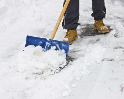 shoveling snow ice icy sidewalk de-icer