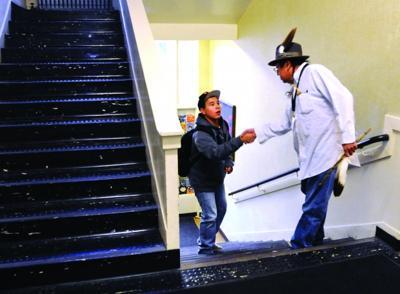 Cecil Crawford greets Willard High School freshman Bob Earthboy