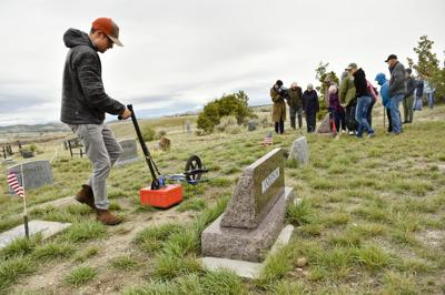 Ethan Ryan, archaeologist and PhD candidate at the University of Montana, illustrates the use of a ground-penetrating radar