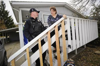 Senior Officer Scott Finnicum, left, and Sheila Sutton