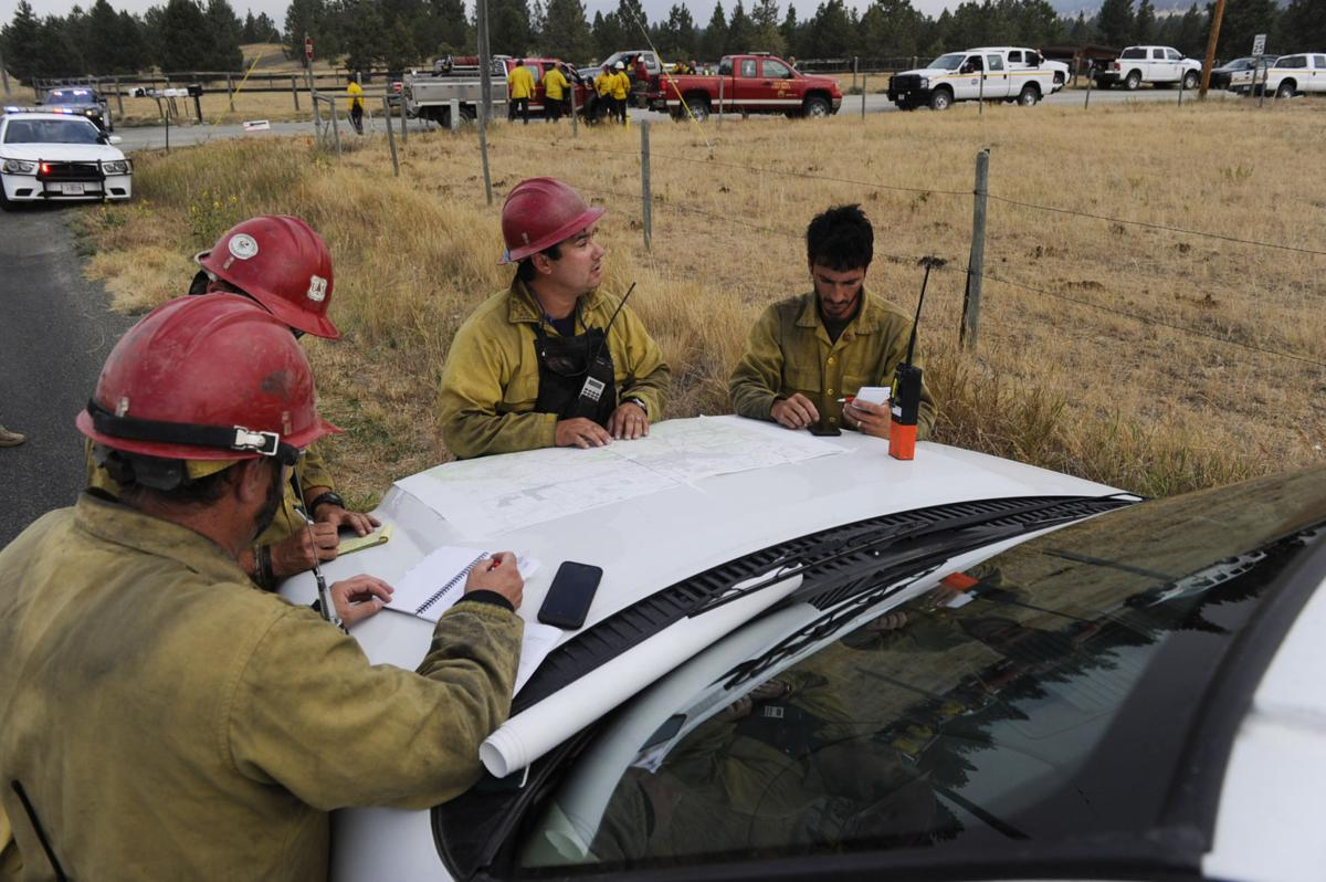 Roughly one hundred personnel and multiple aircraft help battle a lightening caused fire south of Helena Thursday afternoon.