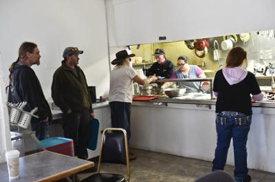 Volunteers serve lunch at God's Love April 17.
