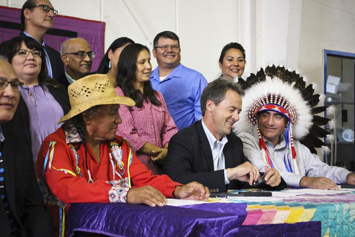 Bullock ceremonially signs bill