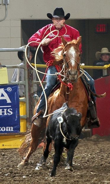 Kyle Whitaker ropes his calf