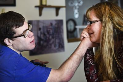 Vicki LaFond-Smith shares a moment with her son Christopher