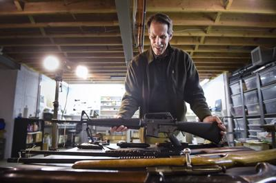 Bruce Seiler, co-founder of The National Center for Unwanted Firearms, handles an AR-15