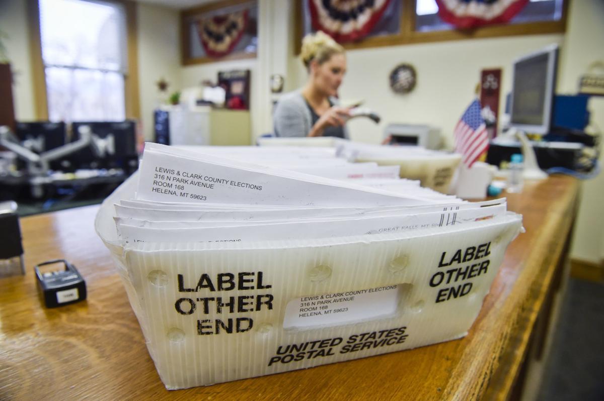 Bins of absentee ballots