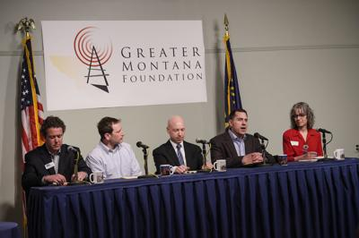 Grant Kier, second from right, answers a question Thursday night