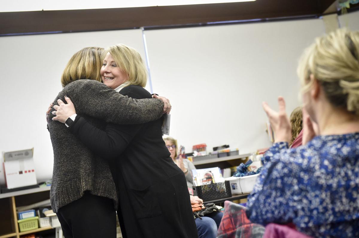 Lisa Cordingley, executive director of the Helena Education Foundation, left, hugs Shannon Callahan