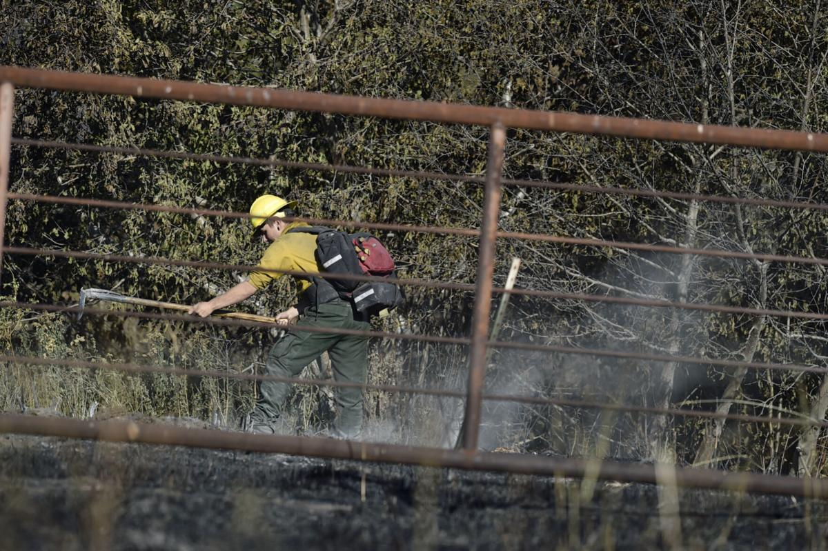 Firefighters mop up along Seven Mile Creek