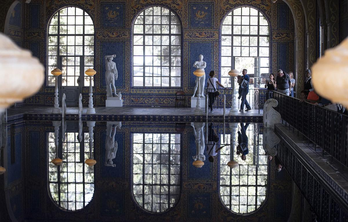Tourists walk through the indoor Roman Pool at Hearst Castle in San Simeon on the coast along Highway One in SAN SIMEON, Calif., on Aug. 1, 2018.