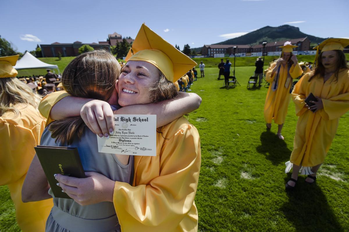 Abby Ekola gives a teacher a hug