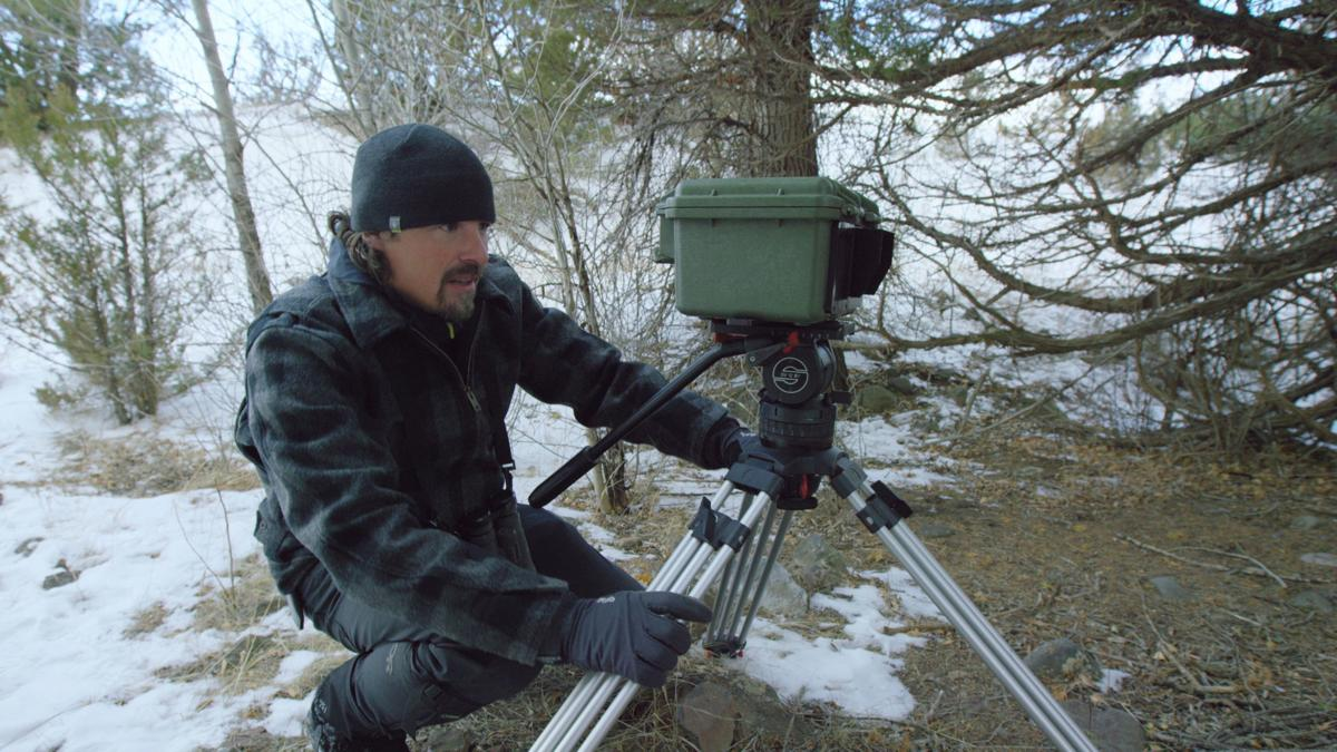 Casey Anderson sets up a camera
