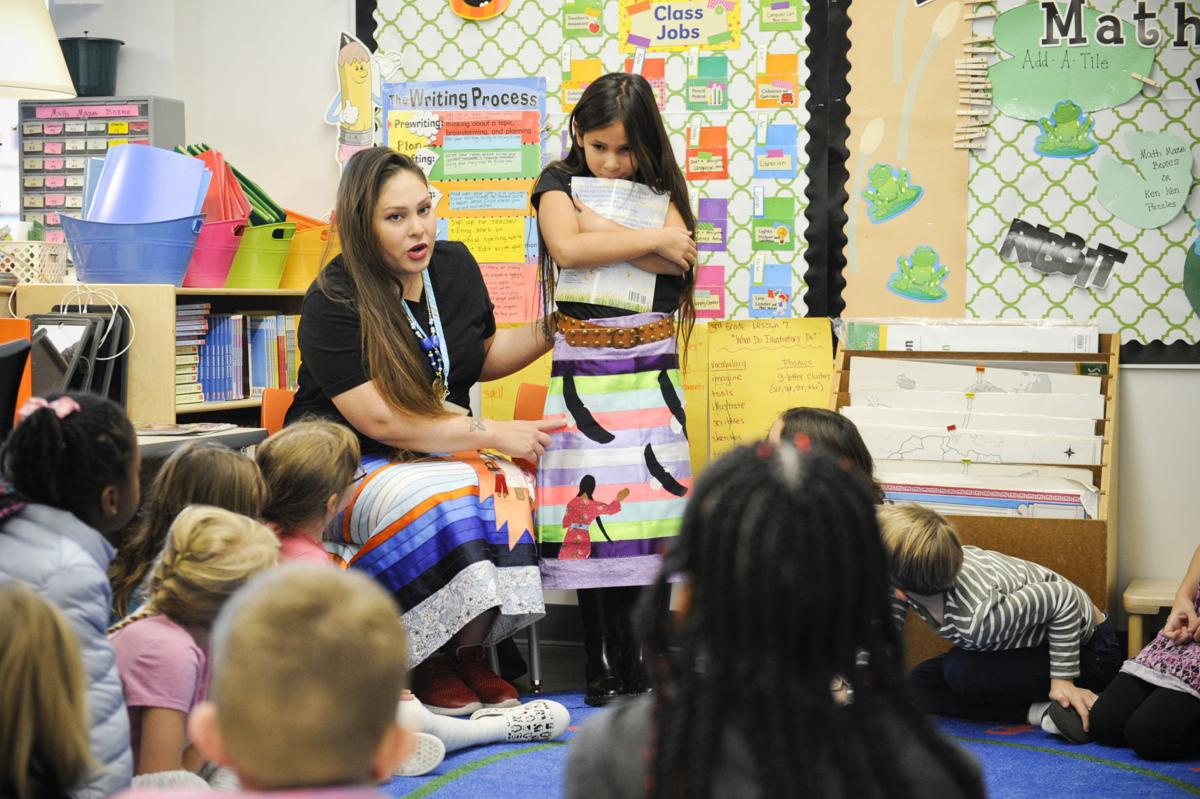 Quincy A. Bjornberg and her daughter Jaylin teach students about Chippewa Cree culture