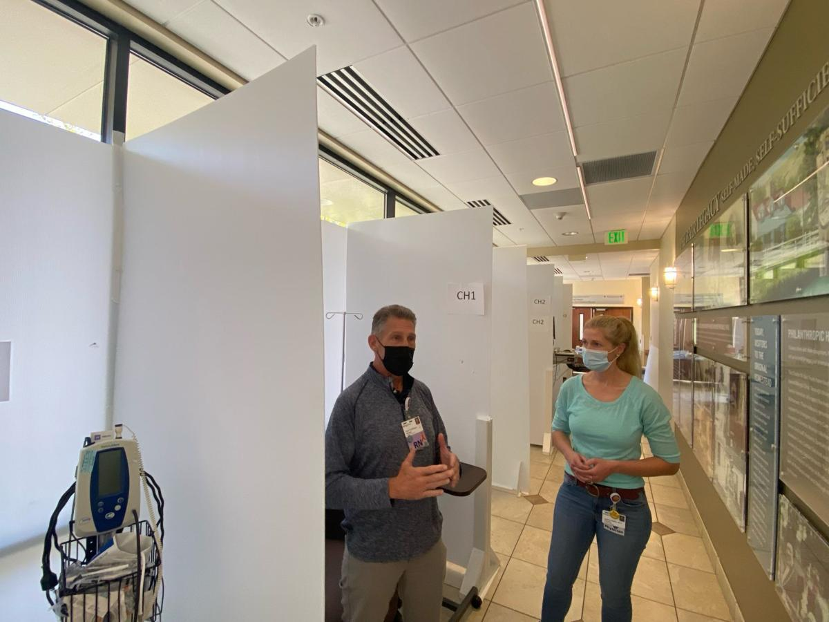 A hallway at Billings Clinic that has been converted into several small patient rooms