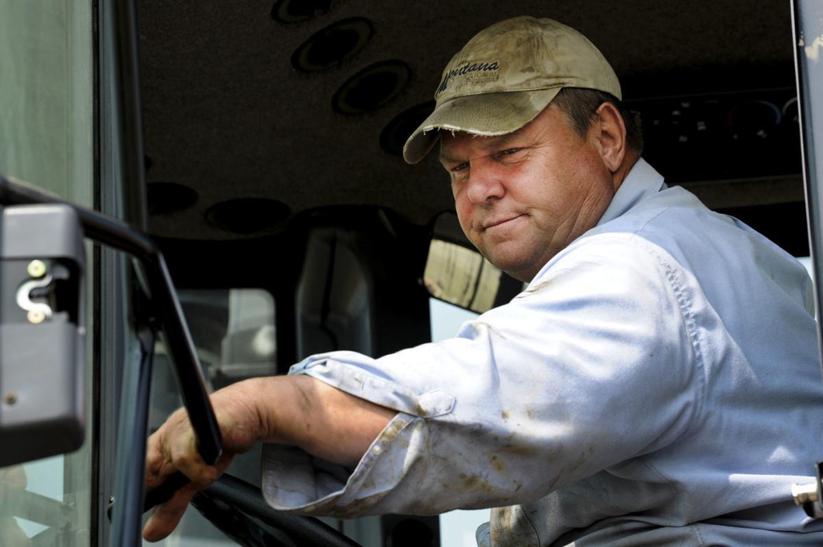 Sen. Jon Tester shuts the door to his tractor