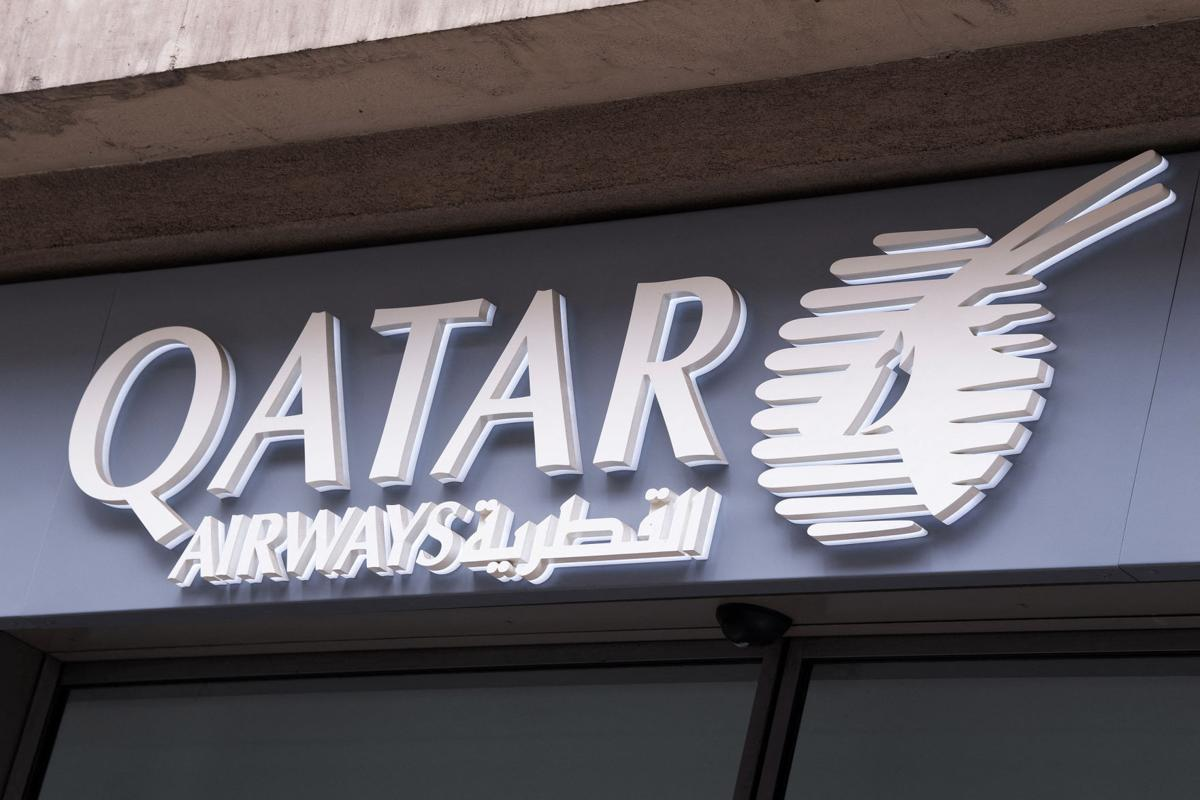 A shop sign of Qatar Airways on May 4, 2020 in Paris, France.   The airline will now require passengers to wear a face shield in addition to a mask throughout their flight.