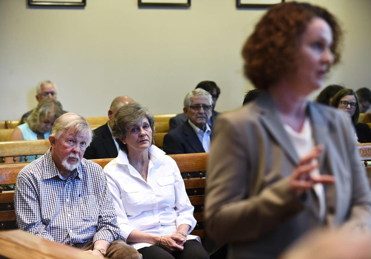 Alan Nicholson and his wife Nancy Nicholson, left, listen to an argument by Helena Public School District's counsel, Beth O'Halloran