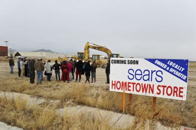 A crowd gathers at the site of the future Sears Hometown
