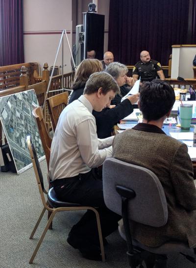 Skyler Schneider sitting at counsel's desk during his 2018 homicide trial