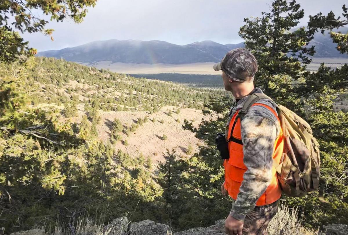 An elk hunter looks out over a vista while hunting the general season last year.
