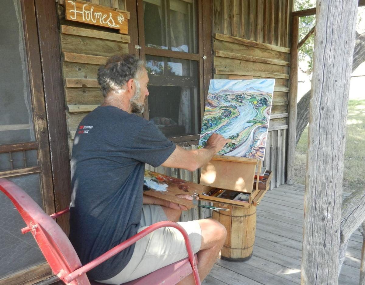 Helena based artist Tim Holmes works on a recent painting.