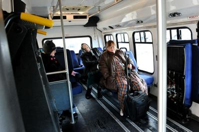 People ride a HATS bus Tuesday morning