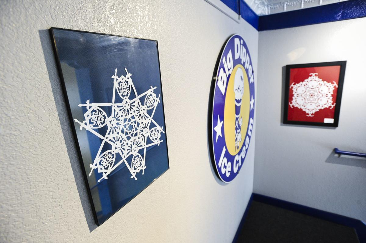 Big Dipper exhibit Cory Krings creates intricately detailed hand- cut snowflakes