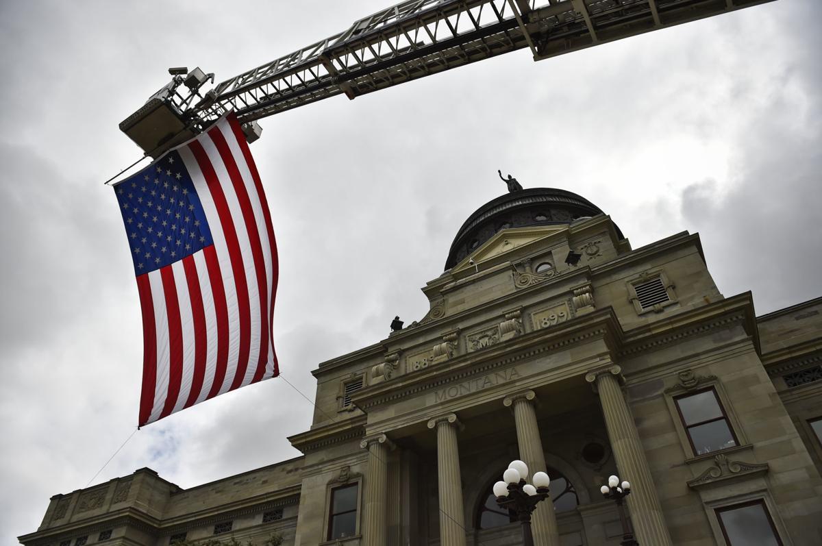 A ladder truck displays an American Flag