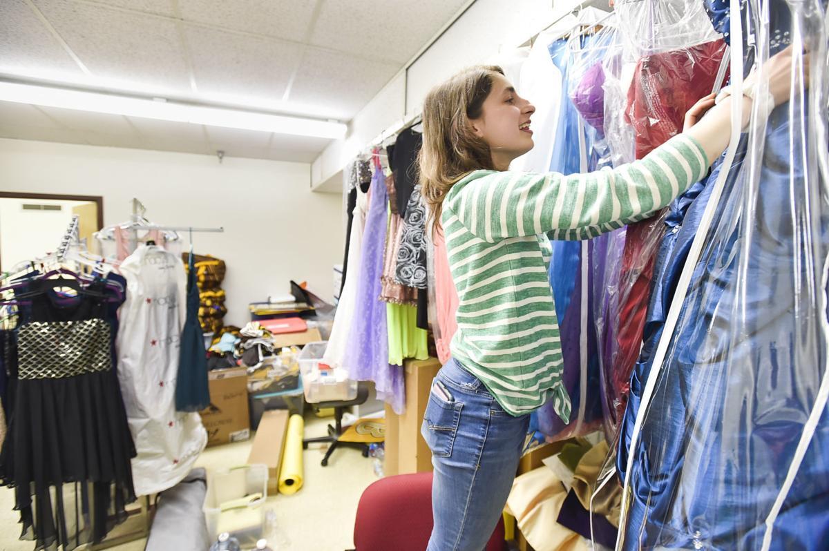 Lauren Helbling sorst through donated prom dresses