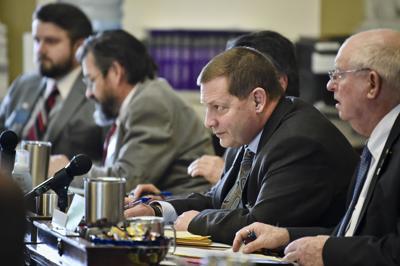 Rep. Ed Buttrey, R-Great Falls, listens to a floor speech
