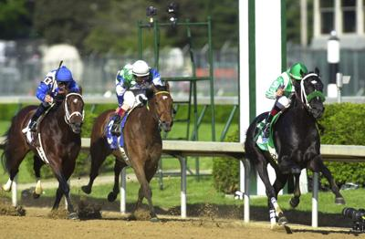 In a 2002 file image, War Emblem, right, with Victor Espinoza up and trained by Bob Baffert, wins the 128th running of the Kentucky Derby at Churchill Downs in Louisville, Ky.