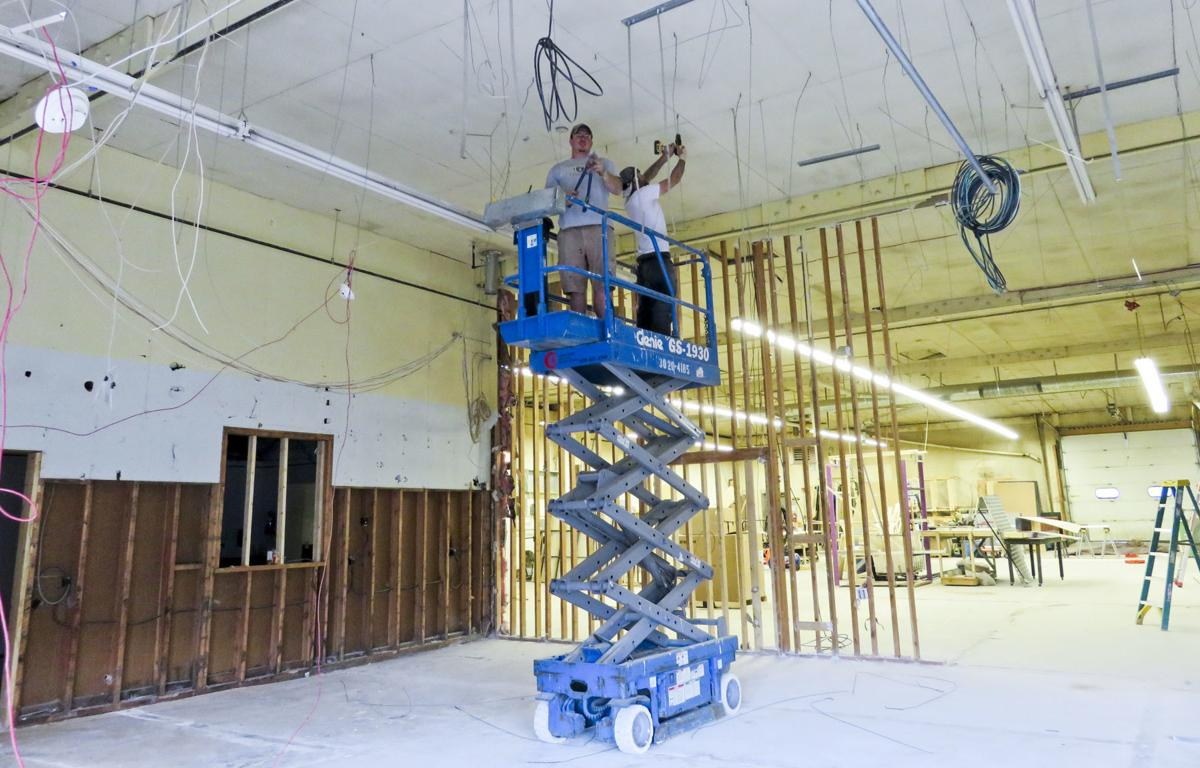 Contractors work on renovating the old Helena Industries building into the new Helena Avenue Theatre.