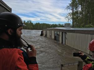 Man pulled safely from raging Clark Fork; new evacuation orders issued Thursday night