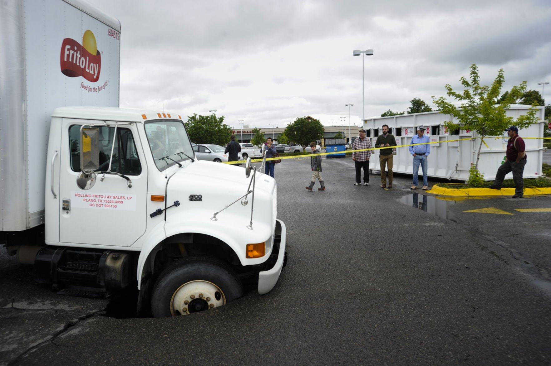 Feature Photo Sinkhole nabs delivery truck at Safeway Local