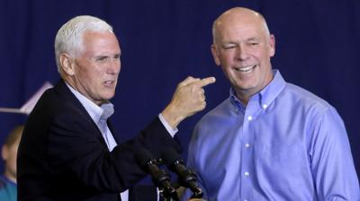 Vice President Mike Pence points to Greg Gianforte