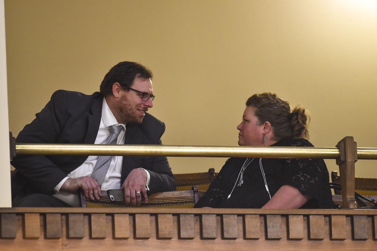 Judge Chris Abbott talks with his partner Jen Gursky