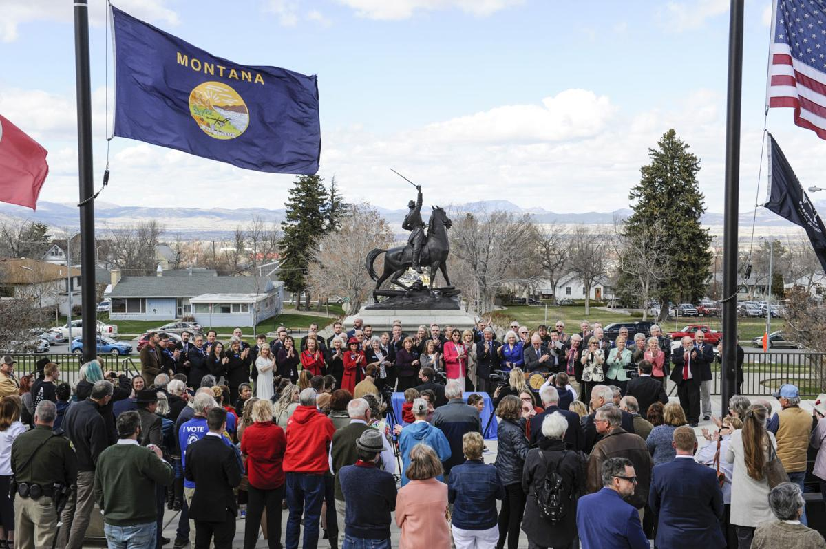A crowd gathers on the steps of the Montana State Capitol