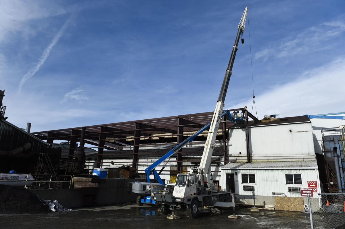 Crews work to construct American Chemet's new building around the old building,