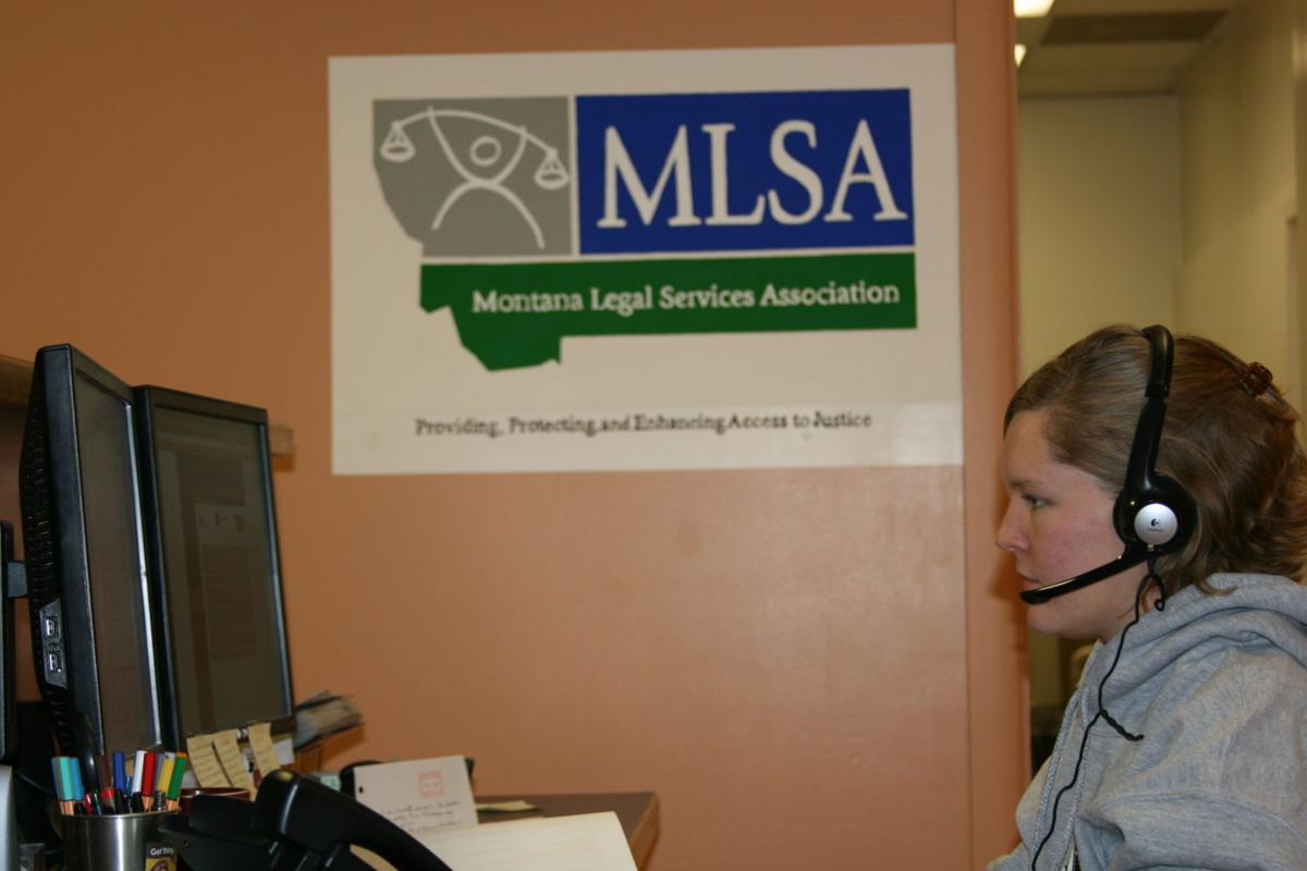 Americorps member answering intake calls at the Montana Legal Services Association.