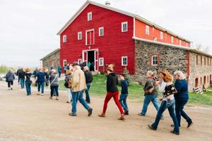 Barn with people walking in front.jpg